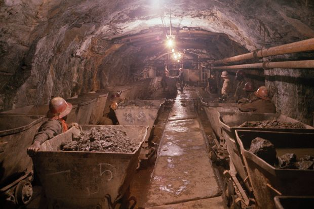 CONGO - SEPTEMBER 09: Miners push radioactive pitchblende, used in atomic bombs, in a shaft, Shinkolobwe, Republic of the Congo (Photo by Willis D. Vaughn/National Geographic/Getty Images)