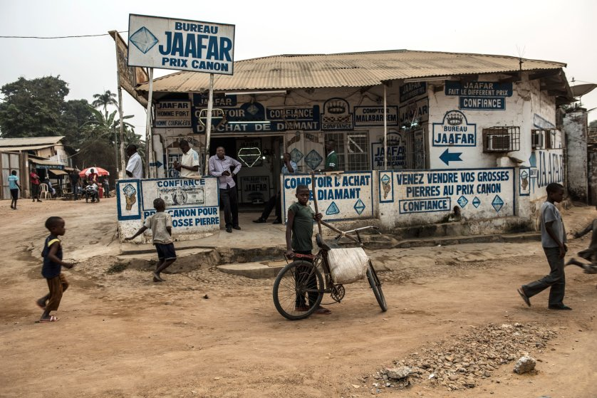 Congolese walk past Jaffar Comptoir, a diamond trading house, in Tshikapa, in Kasai, in the south west region of the Democratic Republic of Congo, August 10, 2015. Diamond buyers and manufacturers in the west are trying to find a way to make the diamond industry cleaner and more responsibly-sourced, in order to combat human rights abuses, child labor, the degradation of the environment, and unfair trade practices. (Credit: Lynsey Addario/ Getty Images Reportage for Time Magazine)